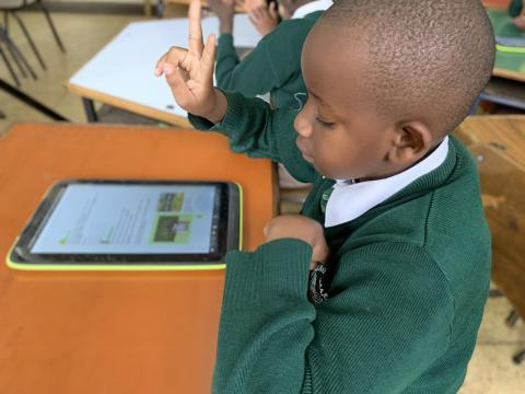 Boy who is deaf learning with an accessible textbook on a tablet