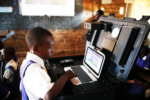 One of the pupil's at Kamurasi P/S P.4 navigates the laptop in the Mobi-station during the lesson.