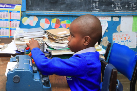 6-year-old Wesley Muturi in his class at Kilimani Primary School in Nairobi, using an abacus to count