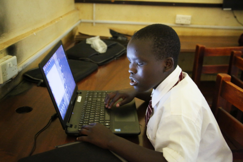 George Ntakimanye a 14-year old visually impaired student uses a laptop computer.