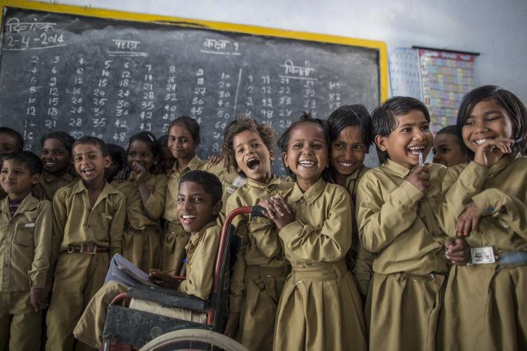 Students pose for photograph inside their classroom at a government primary school in Uttar Pradesh, India